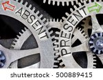 Small photo of Macro photo of tooth wheel mechanism with arrows and ABSENT, PRESENT concept words