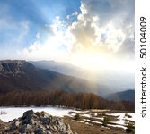 Mountain landscape with sunshine in valley - stock photo