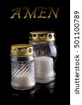 Small photo of Cemetery candles with text AMEN