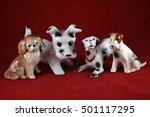 Four Porcelain Dogs  On A Red...