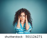 Small photo of Portrait stressed sad young woman isolated blue background. City stress concept