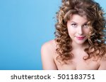 Small photo of Stunning young woman with curly hair, portrait. Model size Plus. Beauty and fashion.