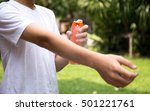 young boy spraying insect... | Shutterstock . vector #501221761