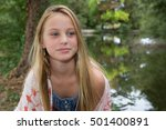 Small photo of Portrait of 10-year-old blond girl
