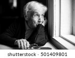 An Elderly Woman Sadly Looking...