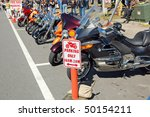"DAYTONA BEACH, FL -MARCH 6: Free parking for motorcycles only during ""Bike Week 2010"" in Daytona Beach, Florida on March 6, 2010.. - stock photo"