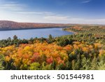 Overlooking a lake surrounded by brilliant fall foliage - Algonquin Provincial Park, Ontario, Canada