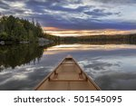 Canoe Bow At Sunset On An...