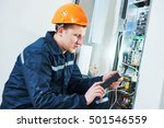 Small photo of Electrician works with electronic equipment