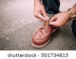 boy is wearing shoes  | Shutterstock . vector #501734815