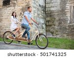 smiling couple riding on retro... | Shutterstock . vector #501741325