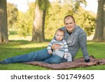 father with children in park.... | Shutterstock . vector #501749605