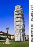Small photo of Tall but leaning tower of Pisa in a Miracoli architecture complex with straight wolverine column against blue sky.