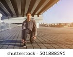 guy tying shoe laces before a... | Shutterstock . vector #501888295