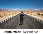 Young Man Walking Alone Throug...