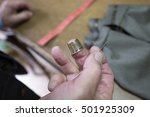 tailor hand's close up holding...   Shutterstock . vector #501925309