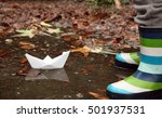 paper boat in autumn puddle... | Shutterstock . vector #501937531