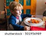 blond child eats tomato pasta... | Shutterstock . vector #501956989