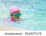 little girl learning to swim in ... | Shutterstock . vector #501957175