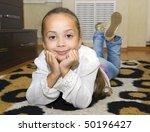 little girl lying on the floor | Shutterstock . vector #50196427