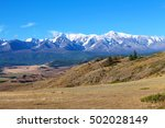Small photo of snow-capped mountains in the Altai mountains