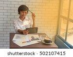 young businessmen sit across... | Shutterstock . vector #502107415