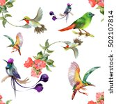 Stock photo watercolor hand drawn seamless pattern with beautiful flowers and colorful birds on white background 502107814