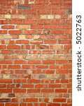Colorful old red brick wall. - stock photo