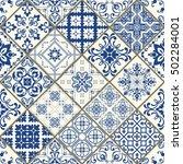 seamless patchwork tile in blue ... | Shutterstock .eps vector #502284001