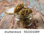 Marijuana Buds In The Glass Pot
