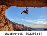 male climber gripping on... | Shutterstock . vector #502398664