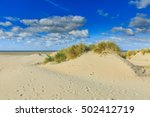 Sandy Beach With Solitary Dune...