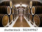 Rows Of Wine Barrels In An...