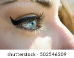 close up of young woman's blue... | Shutterstock . vector #502546309