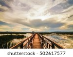 wooden bridge in lotus lake on... | Shutterstock . vector #502617577