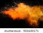 orange powder isolated on black ...   Shutterstock . vector #502630171