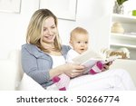 young mother with baby on a... | Shutterstock . vector #50266774