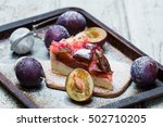 plum pie or tart and plums on... | Shutterstock . vector #502710205