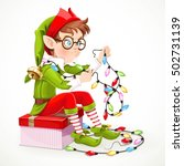 cute boy elf sitting on a box...