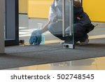a woman cleaning the door.   Shutterstock . vector #502748545