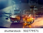 whiskey bourbon in a glass with ... | Shutterstock . vector #502779571