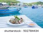 boiled snails dishes on... | Shutterstock . vector #502784434