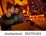 young couple looking on laptop... | Shutterstock . vector #502791301