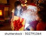 santa claus opening magic gift ... | Shutterstock . vector #502791364