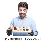 young man eating sushi on white ... | Shutterstock . vector #502814779