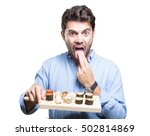 young man eating sushi on white ... | Shutterstock . vector #502814869