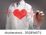 doctor drawing ecg heartbeat... | Shutterstock . vector #502856071