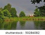 pond a rainbow near city - stock photo