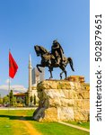 Small photo of TIRANA, ALBANIA - SEPTEMBER 23, 2013: Skanderberg monument on the Skanderbeg Square, the main plaza named in 1968 after the Albanian national hero Skanderbeg, on September 23, 2013, Tirana, Albania