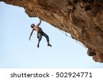 male rock climber hanging with... | Shutterstock . vector #502924771